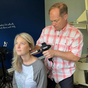 Chiropractor Hernando MS Clay Morton Adjusting Patient
